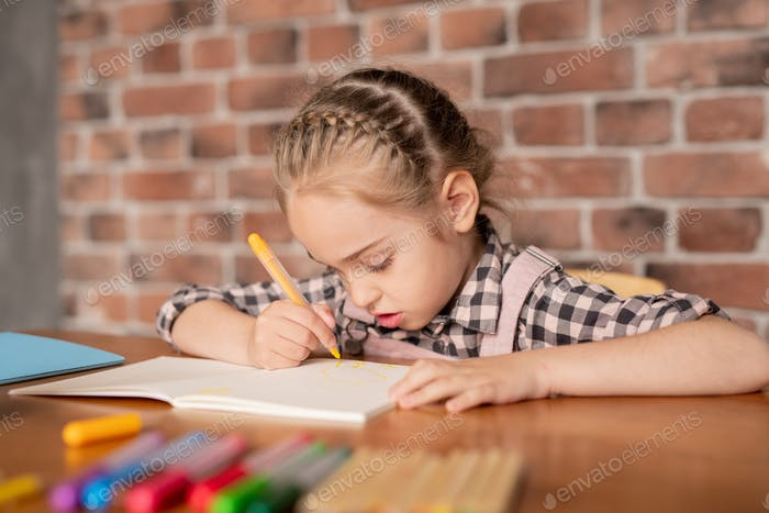 Creative girl drawing in notebook