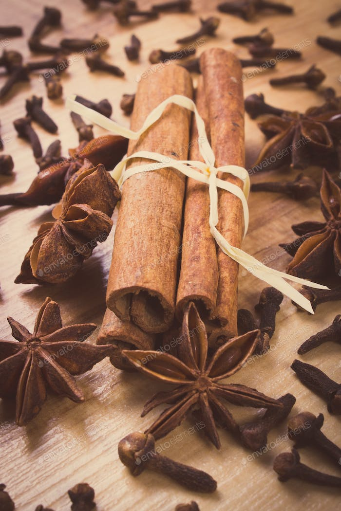 Vintage photo, Star anise, cinnamon sticks and cloves on wooden table, seasoning for cooking