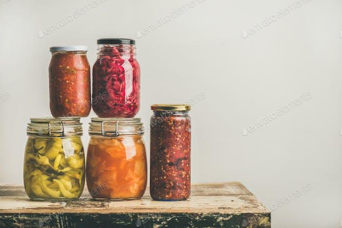 Autumn seasonal pickled or fermented vegetables in jars, copy space