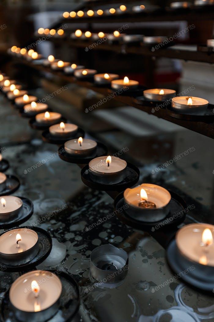 Many candles burning