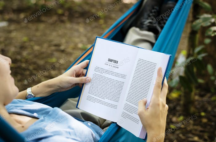 Woman reading a book in a hammock