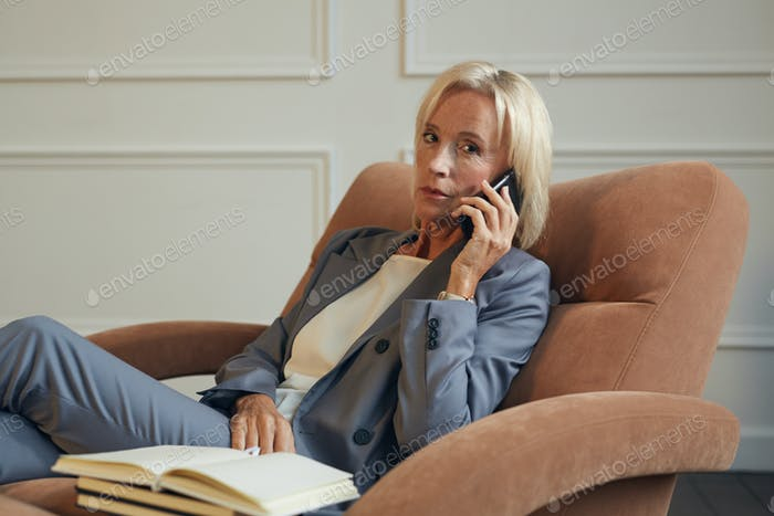 Successful Businesswoman Speaking by Phone