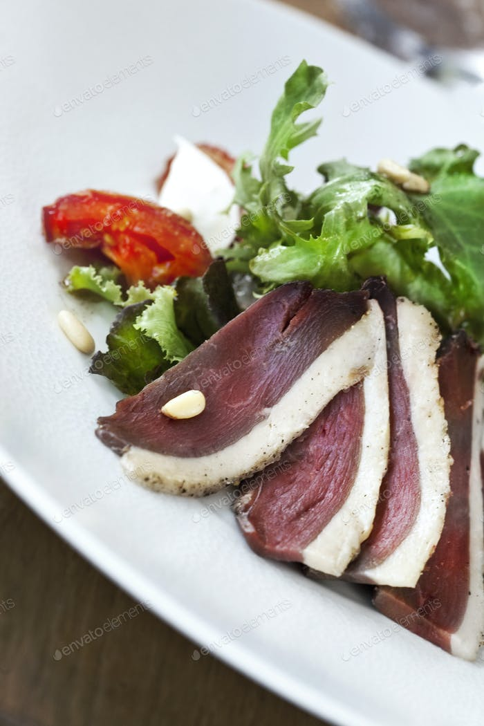 Duck salad on a plate