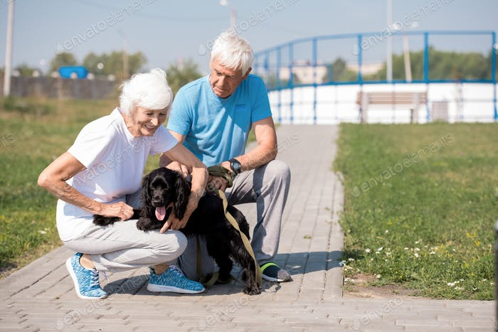 Happy Senior Couple with Pet Dog