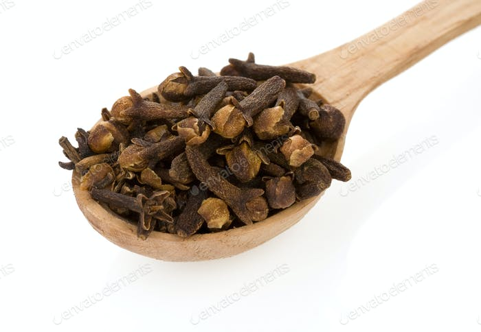 clove spices in spoon on white