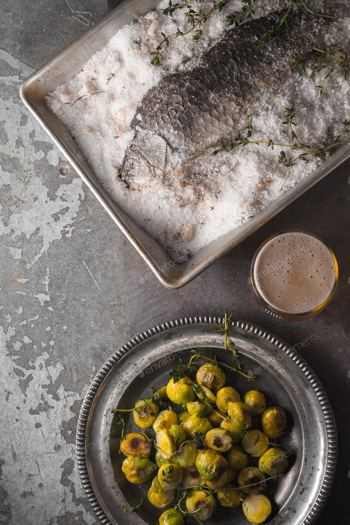 Fish baked in salt with Brussels sprouts and beer