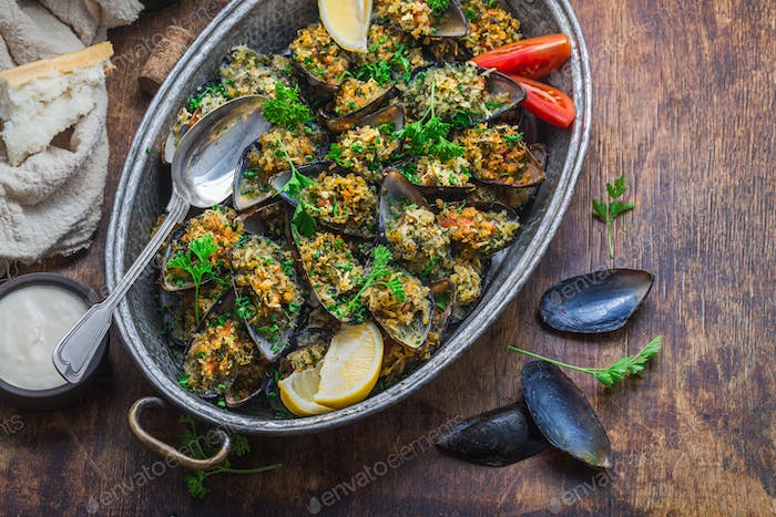 Mussels baked with cheese parmesan and bread crumbs, wine appetizer