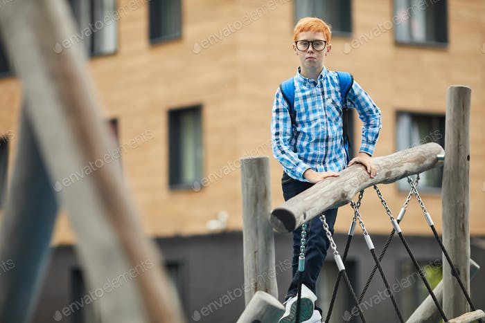 Schoolboy playing on the playground