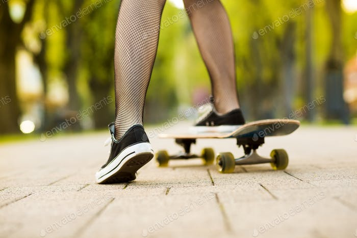 Female feet on skateboard