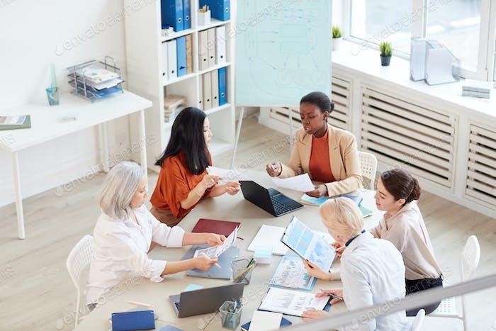Female Business Team Meeting in Modern Office