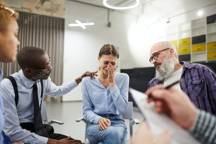 Young Woman Crying in Support Group