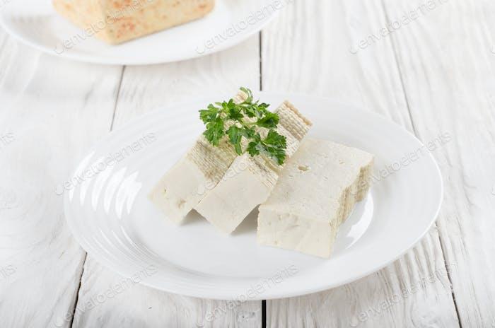 Soy Bean curd tofu on clay dish closeup. Non-dairy alternative s