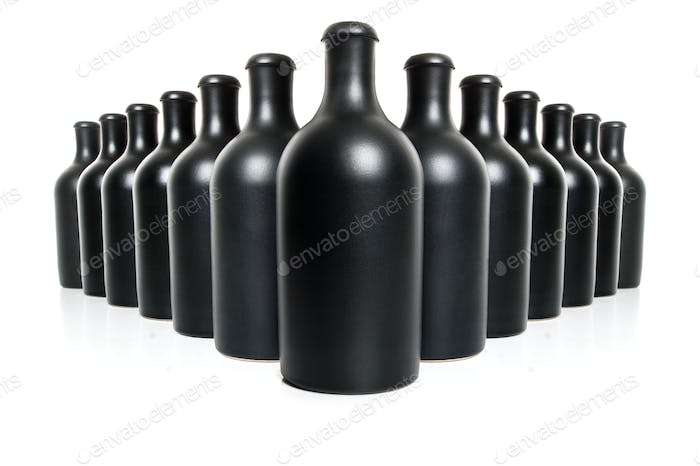 Set of black clay bottles on a white background.