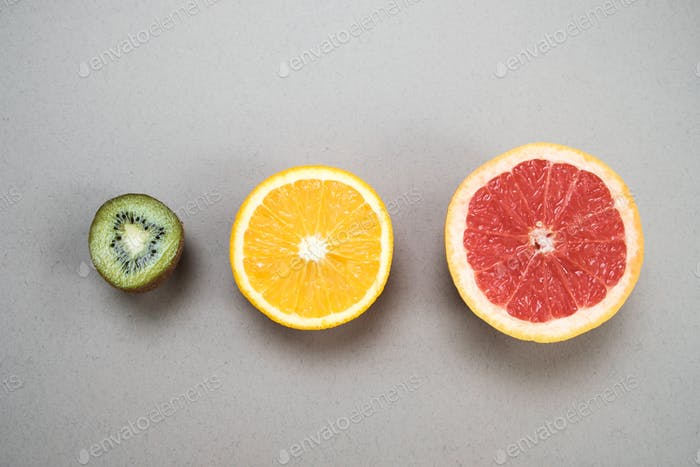 Minimal fruit background. Top view of sliced citrus fruits