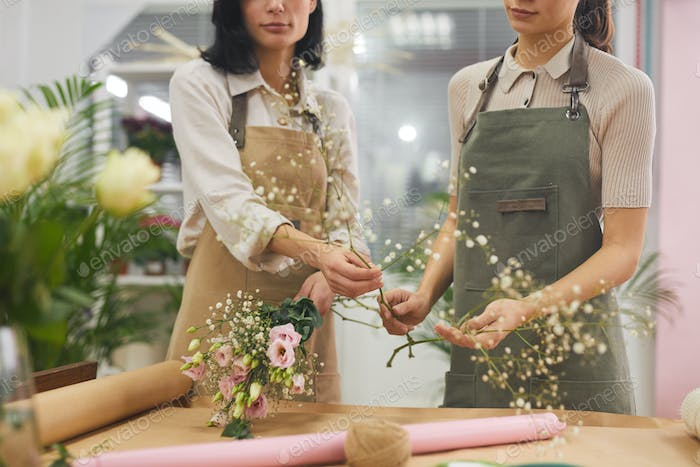 Florists Arranging Flowers in Shop
