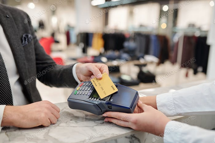 Paying with contactless card in shop