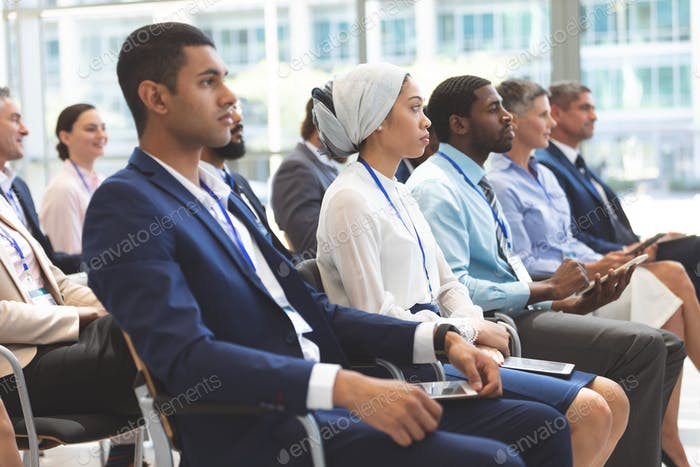 Business people looking serious at business seminar in office building