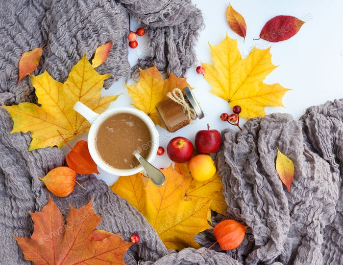 Autumn composition. Fall leaves, cup of coffee, chocolate paste