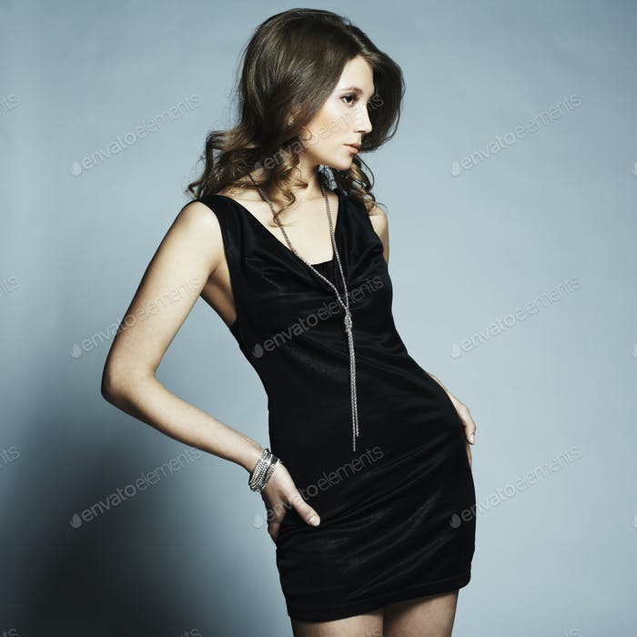 Fashion portrait of young beautiful elegant woman