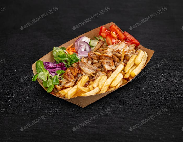 Doner kebab on a paper plate