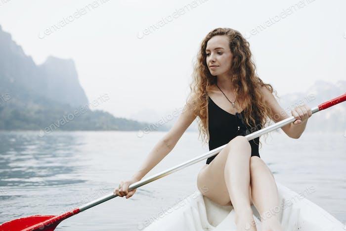 Woman paddling a canoe through a national park