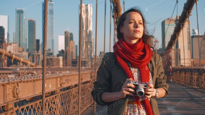Young photographer on the Brooklyn Bridge in NYC