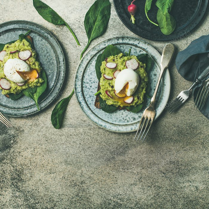 Healthy vegetarian breakfast flat-lay. Avocado and egg toasts, square crop