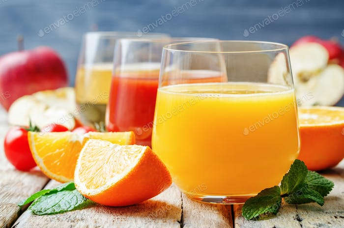 set of juices: orange, tomato and apple