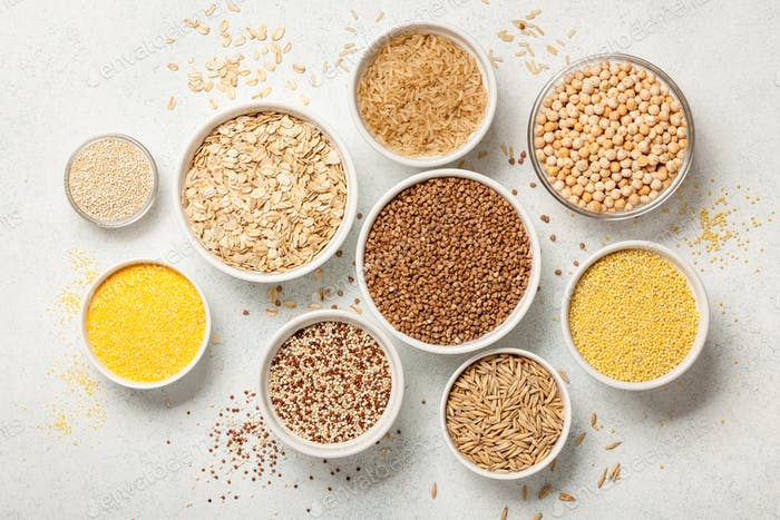 Set with various cereal grains on stone background