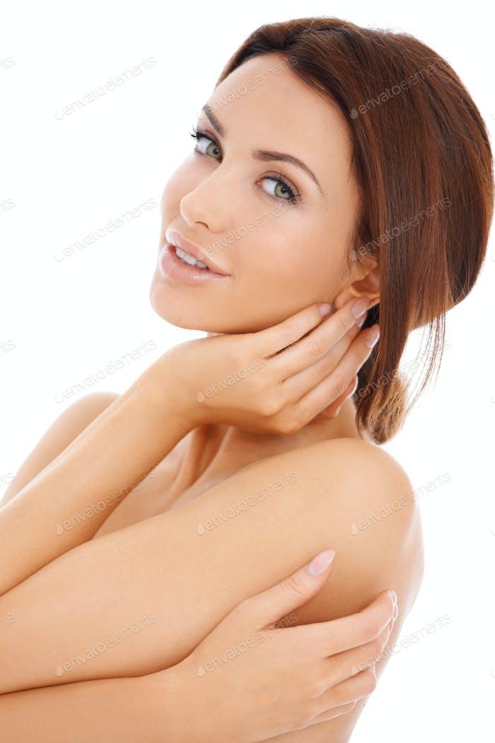 Alluring beautiful woman posing topless