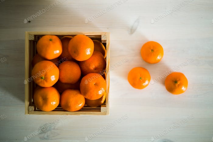 Wooden box of fresh mandarin fruits