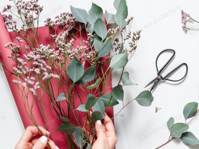 Girl creates a bouquet