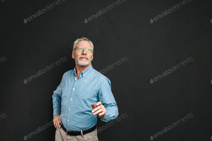 Portrait of elderly man 70s with grey hair and beard wearing for