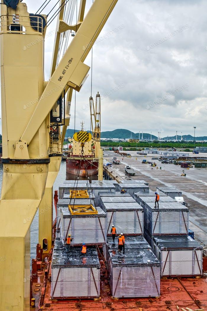 ฉargo loading  into the ship in port shipyard