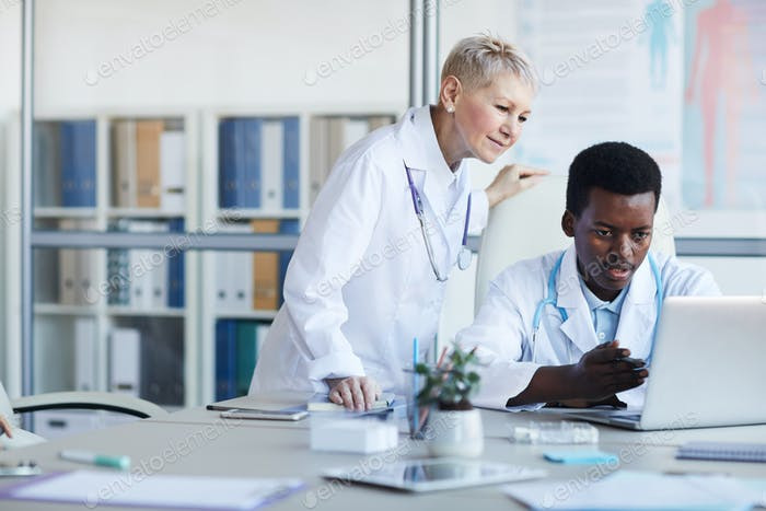 African Med Student Using Laptop