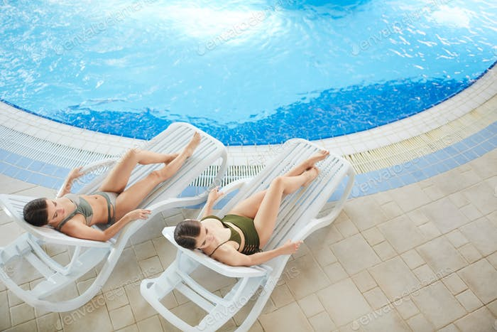 Beautiful Women Relaxing by Pool Above View