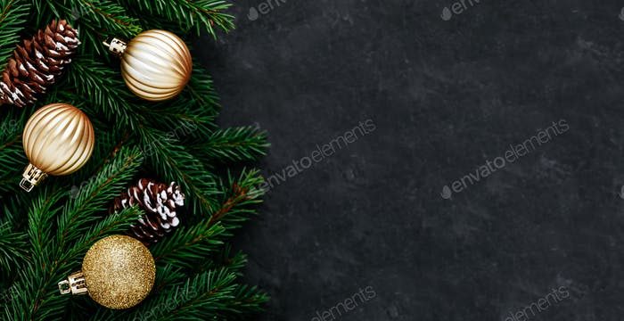 Christmas background with a green fir branches and gold decor.
