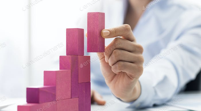 Businesswoman building a growing financial chart