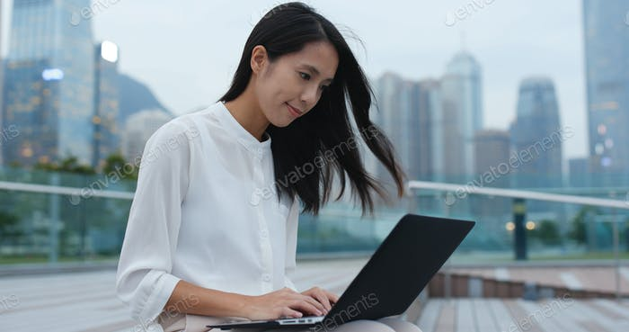 Asian business woman use of laptop computer in Hong Kong