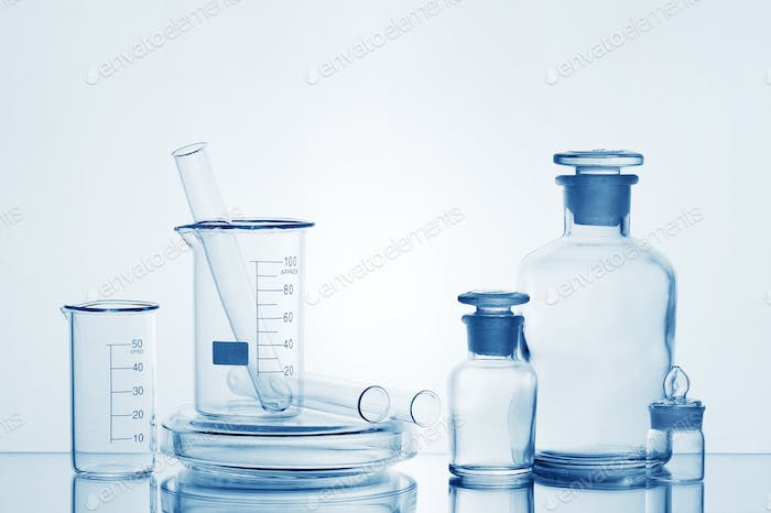 Laboratory Transparent Glassware on White