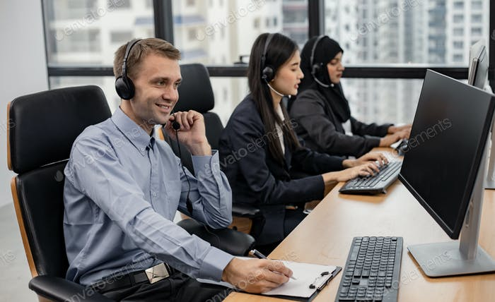 Group of diverse telemarketing customer service staff team in call center.