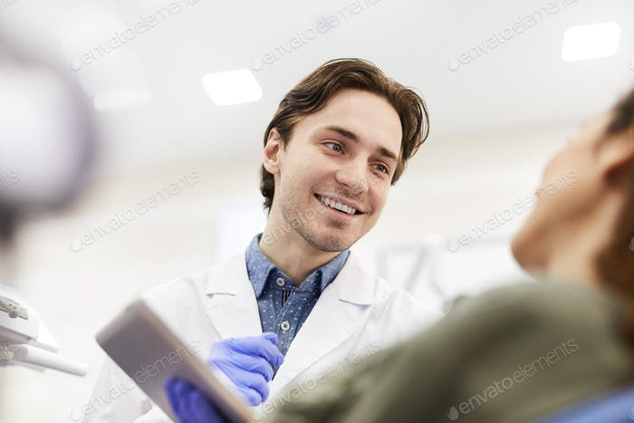 Dentist Consulting Patient