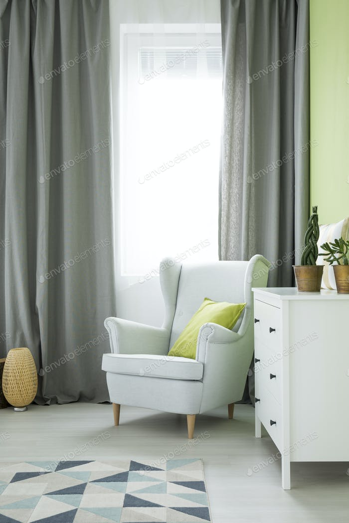 Room with armchair and dresser