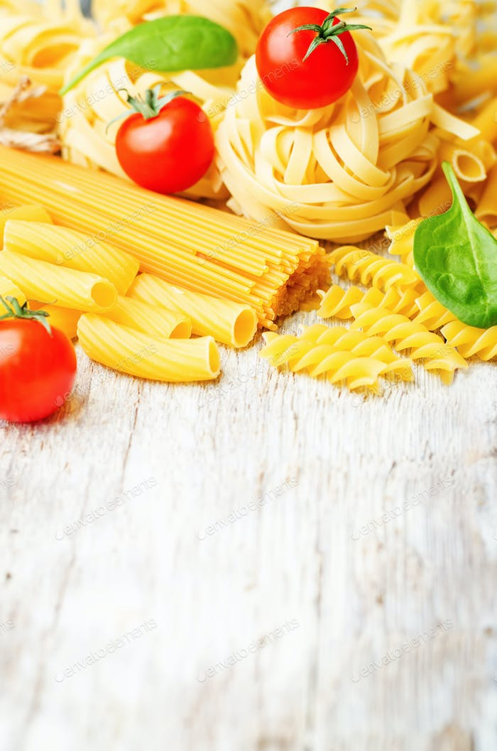 different pasta with tomatoes and spinach