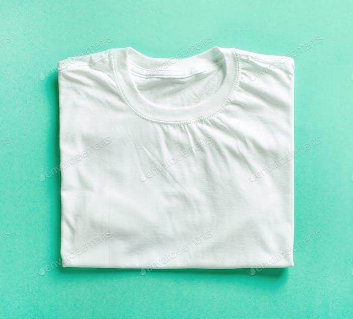 white folded t shirt