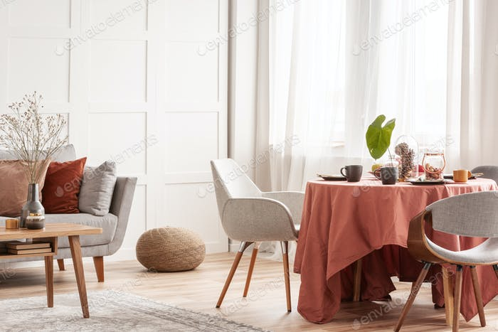 Chairs at dining room table set for easter family meeting