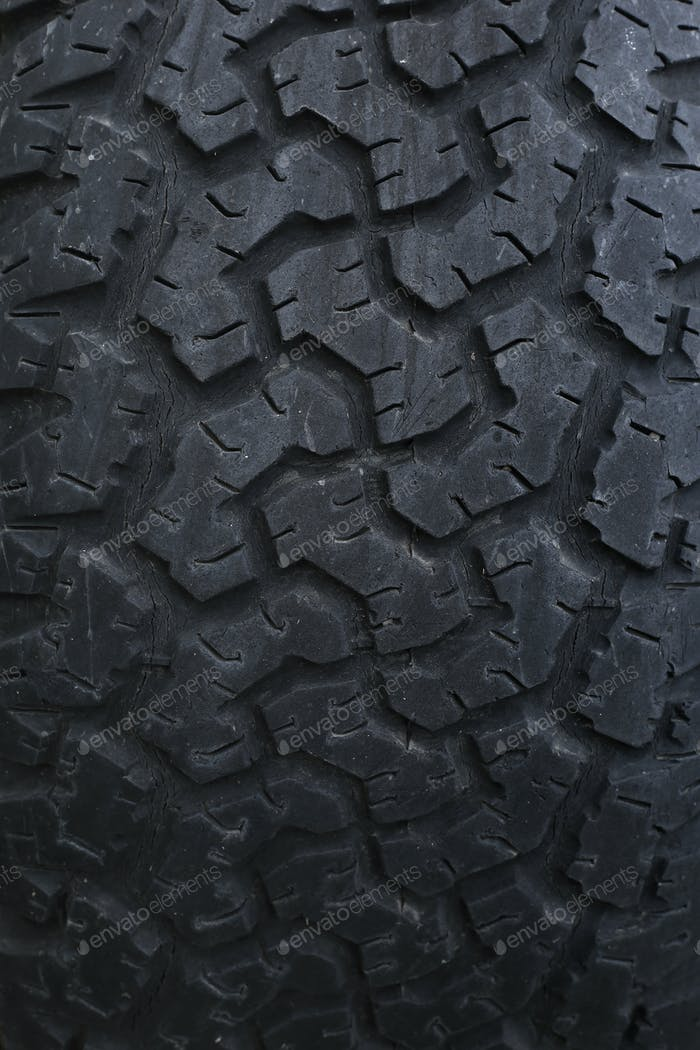 Closeup on a tire on a dark background