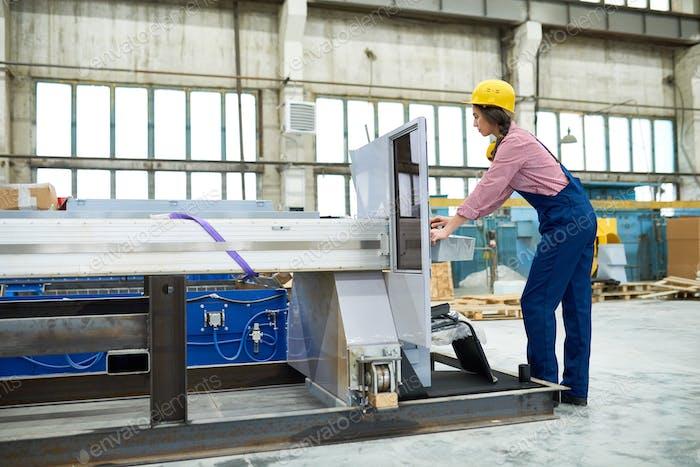 Woman working on plasma cutting equipment