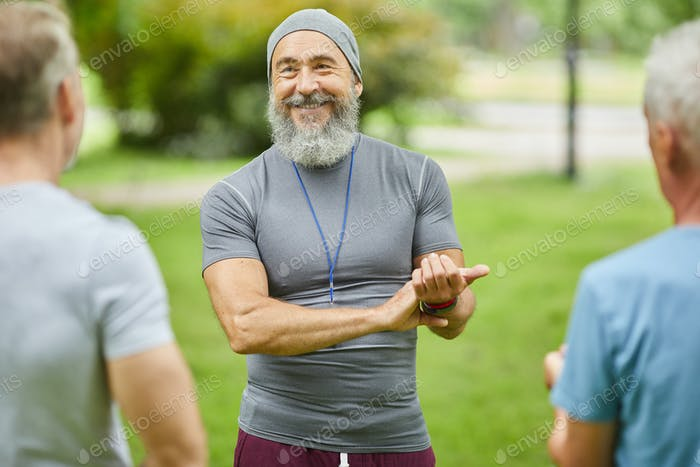 Aged Trainer Checking Heart Beat