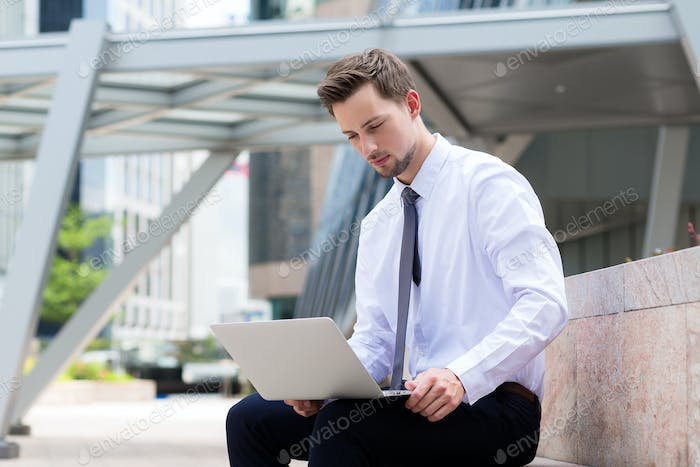 Caucasian businessman use of the laptop computer